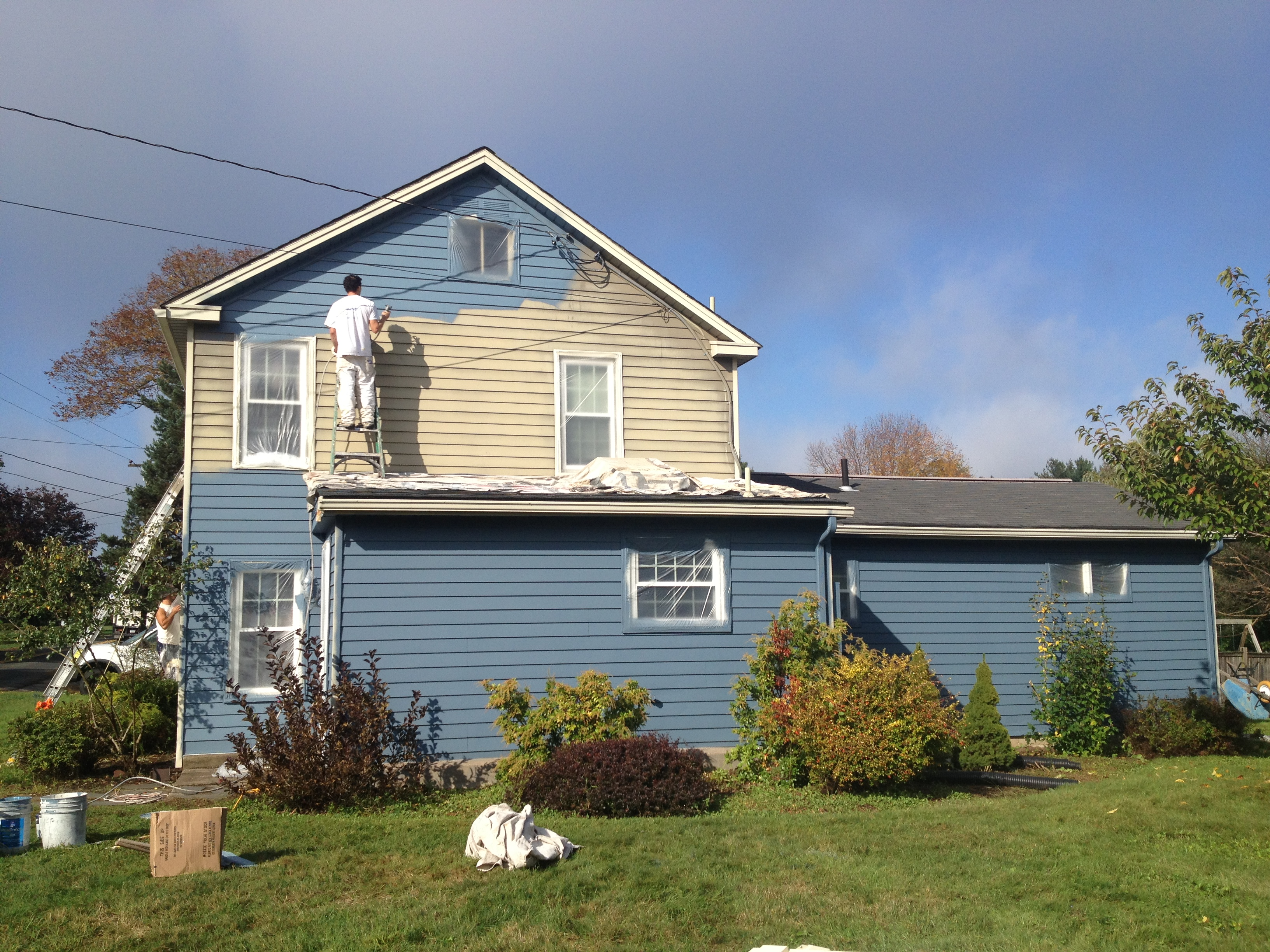 How often does the exterior of a house need painting in for Exterior house finishes
